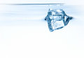 Free Ice Cube In Water Royalty Free Stock Image - 23559546