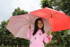 Free Little Girl Under Umbrellas Royalty Free Stock Photo - 23553585