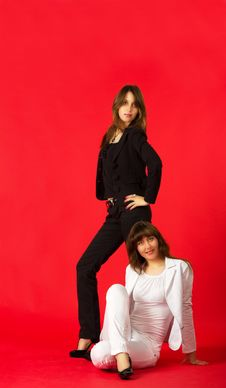 Sisters Twins Posing In Studio Stock Photo