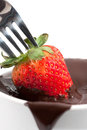 Free Strawberry Being Dipped In Chocolate Royalty Free Stock Images - 23565359