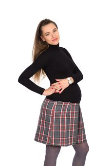 Free Nice Pregnant Girl In Plaid Skirt Stock Images - 23564364
