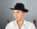 Free Portrait Of Young Man In A Hat Royalty Free Stock Photography - 23577187