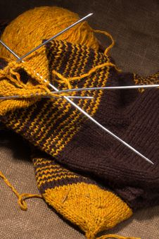 Free Woollen Scarf With  Knitting Needles. Stock Photography - 23580382