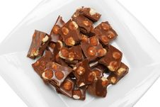 Free Broken Chocolate Pieces With Nuts On Plate Stock Photos - 23581723
