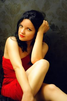 Brunette In Red Dress Stock Images