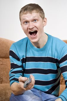 Free The Guy Shouts Happily, Watching Tv Royalty Free Stock Photography - 23589837