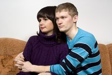 Boy And Girl Sitting On The Couch Royalty Free Stock Image