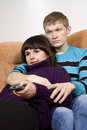 Free A Guy And A Girl Watching Tv Stock Photography - 23590052