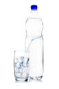 Free Bottle Of Mineral Water And Glass Stock Photo - 23597830