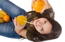 Girl With Orange Juice And Fruit Royalty Free Stock Images