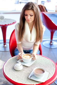Free Young Woman Sitting In The Cafe With A Cup Of Tea Stock Photography - 23591482