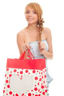 Free Beautiful Young Woman Holding A Red Bag Stock Image - 23592611