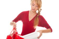 Free Beautiful Young Woman Puts A Purchase Stock Images - 23592684
