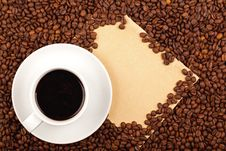 Cup Of Coffee And Paper Royalty Free Stock Image