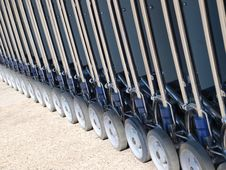 Free Row Of Luggage Carts Wheels Stock Images - 23598044