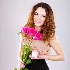 Free Woman With Red Flowers In The Studio Stock Image - 23599961