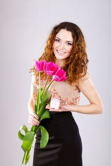 Free Woman With Red Flowers In The Studio Royalty Free Stock Images - 23599969