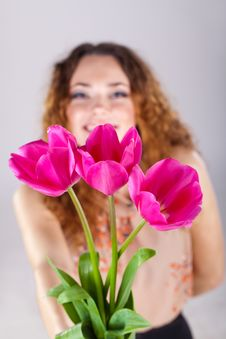 Free Woman With Red Flowers In The Studio Stock Image - 23599981