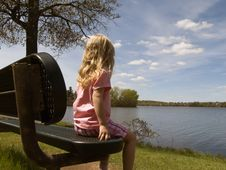 Free Girl Sitting By Lake Royalty Free Stock Images - 2362279