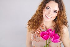 Free Woman With Red Flowers In The Studio Royalty Free Stock Image - 23600006