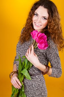 Free Woman With Red Flowers In The Studio Royalty Free Stock Photo - 23600055