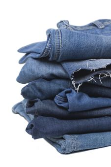 Free Stack Of Blue Jeans Isolated On White Royalty Free Stock Images - 23601499