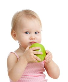 Free Baby Girl With Healthy Food. Isolated Royalty Free Stock Image - 23603556