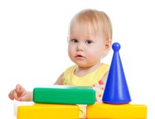 Free Baby Playing With Colorful Toys. Isolated Stock Images - 23603574
