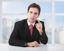 Free Successful Businessman Seriously Sitting At Desk Royalty Free Stock Photo - 23607915