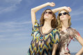 Free Two Beautiful Girl In Sunglasses On Blue Sky Royalty Free Stock Photos - 23613668