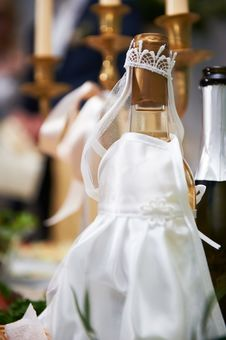 Free Bottle Of Champagne In Costumes Of Bride Stock Image - 23612341