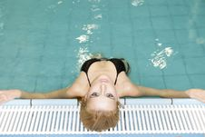Free Beautiful Young Woman Standing In A Swimming Pool Royalty Free Stock Photography - 23613397