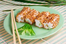 Sushi Rolls With Sesame Seeds, Avocado, Fish Royalty Free Stock Images