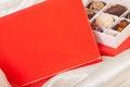 Free Box Of Chocolates On White Satin Background Stock Photo - 23622770
