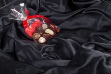 Free Transparent Bag With Chocolates On Black Royalty Free Stock Images - 23622999