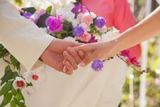 Free Holding Hands With Floral Background Stock Photography - 23623642