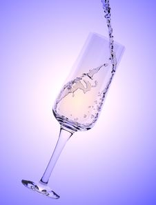 White Wine Being Poured In A Wine Glass Royalty Free Stock Images