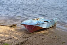 Free Metal Boat On The Riverbank Royalty Free Stock Photos - 23626808