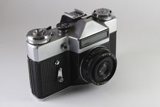 The Old Soviet SLR Camera On Grey Background Royalty Free Stock Photo