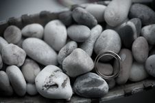 Free Wedding Rings On See Stones Stock Photos - 23629943