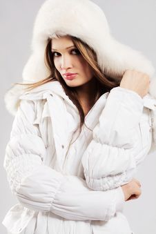 Free Beautiful Woman In White Winter Clothes Royalty Free Stock Photography - 23629987