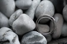 Wedding Rings On Sea Stone Stock Images