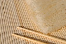 Free Rice Needles On A Bamboo Place Mat Stock Image - 23632081