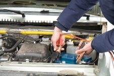 Free A Mechanic Using Jumper Cables Stock Image - 23660321