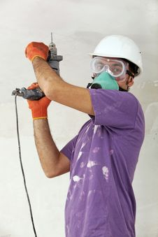 Free Handyman Holding Drill Royalty Free Stock Photo - 23661325