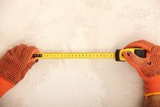 Free Hands Holding A Measuring Roulette Stock Photos - 23661453