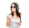 Free Beautiful Girl Listens To Music Through Earphones Royalty Free Stock Image - 23672946