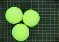 Free Three Tennis Balls On A Racket Strings Stock Photography - 23678252