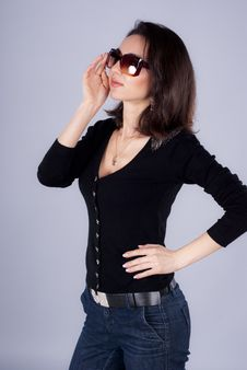 Young Woman Is In Sunglasses Stock Photo