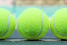 Free Brand New Tennis Balls Arranged In A Row Stock Photography - 23678582